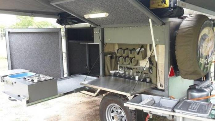 4X4 HUNTER's CAMPING TRAILER with lockable vault.
